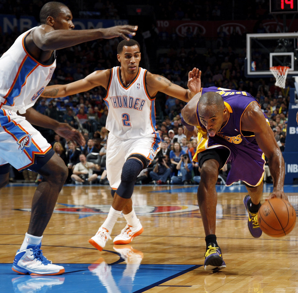 Los Angeles\' Kobe Bryant (24) drives the ball between Oklahoma City\'s Thabo Sefolosha (2) and Serge Ibaka (9) during an NBA basketball game between the Oklahoma City Thunder and the Los Angeles Lakers at Chesapeake Energy Arena in Oklahoma City, Friday, Dec. 7, 2012. Oklahoma City won, 114-108. Photo by Nate Billings, The Oklahoman
