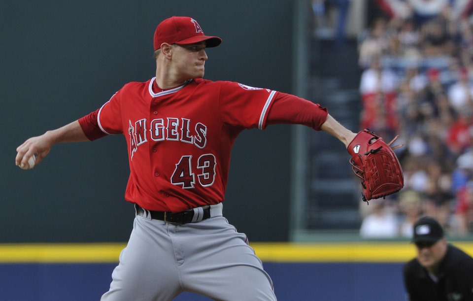 Photo - Los Angeles Angels starting pitcher Garrett Richards (43) holds Atlanta Braves' B.J. Upton on first base during the first inning of a baseball game on Saturday, June 14, 2014, in Atlanta. (AP Photo/David Tulis)