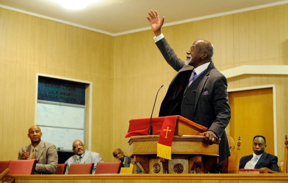 Photo - Dr. Anthony Brooks ends his keynote speech celebrating the life and work of Dr. Martin Luther King, Jr. during the Henderson County Black History Committee's program at Greater Norris Chapel Baptist Church in Henderson, Ky Sunday Jan. 19, 2014. (AP Photo/The Gleaner, Darrin Phegley)