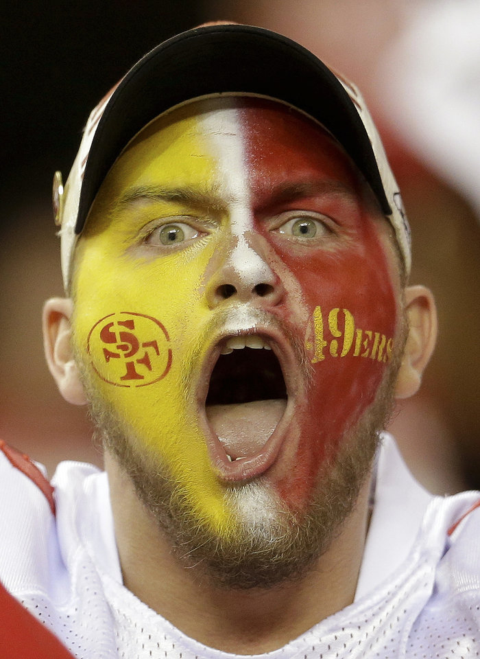Photo - A San Francisco 49ers fan react after the NFL football NFC Championship game against the Atlanta Falcons Sunday, Jan. 20, 2013, in Atlanta. The 49ers won 28-24 to advance to Super Bowl XLVII. (AP Photo/Mark Humphrey)