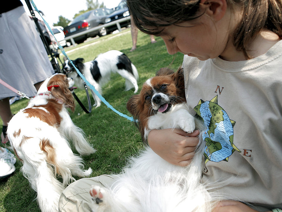 Above: Grace Milsten, 10, of Nichols Hills, holds Marco during the 13th annual Pooch Parade in Nichols Hills.