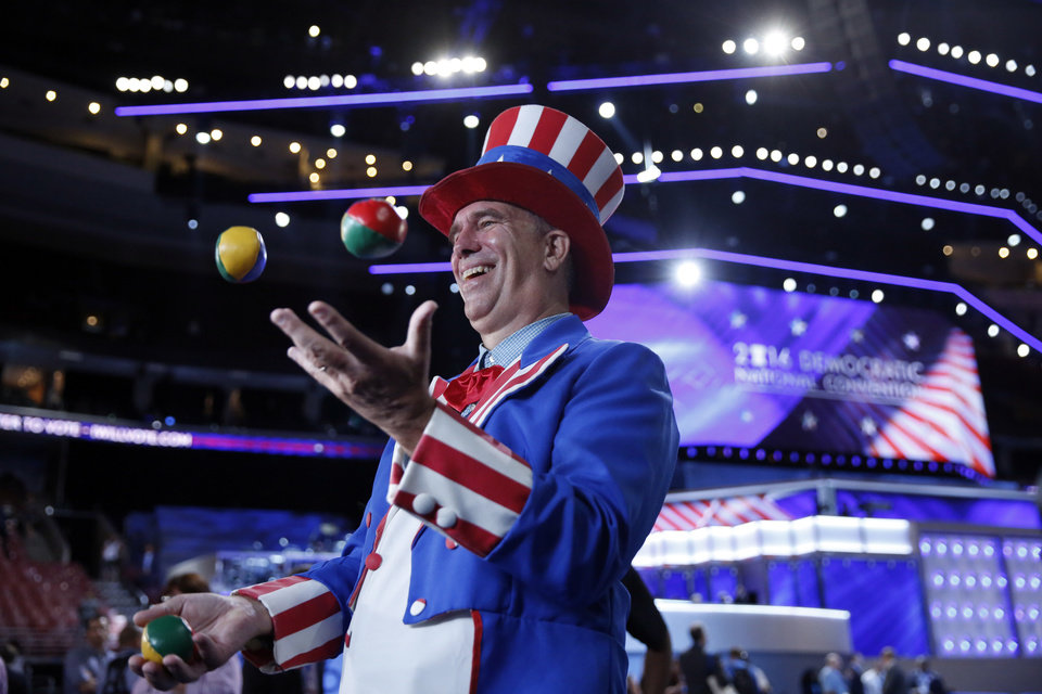 Photo - Alvin Peters from Panama City, Fla., juggles as he arrives at Well Fargo Arena before the start of the first day of the Democratic National Convention in Philadelphia, Monday, July 25, 2016. (AP Photo/Matt Rourke)