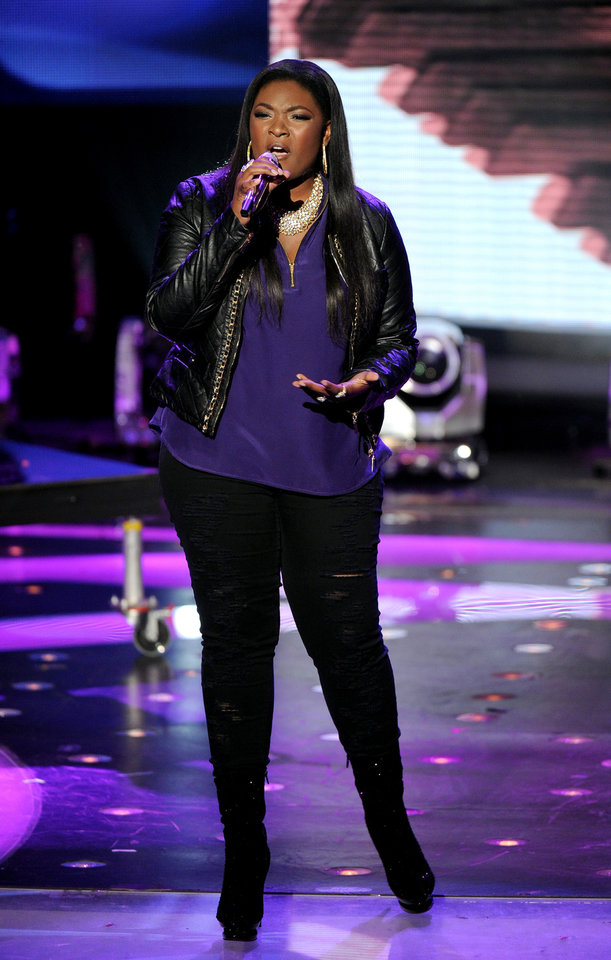 Photo - FILE - In this Wednesday, May 1, 2013 photo released by FOX, contestant Candice Glover performs onstage at FOX's American Idol Season 12 Top 4 To 3 Live Performance Show, in Hollywood, Calif. The current 12th season is set to conclude next Thursday, May 16, 2013, with a showdown between the 23-year-old R&B vocalist Glover of St. Helena Island, S.C., and 22-year-old country crooner Kree Harrison of Woodville, Texas. (AP Photo/FOX, Frank Micelotta)