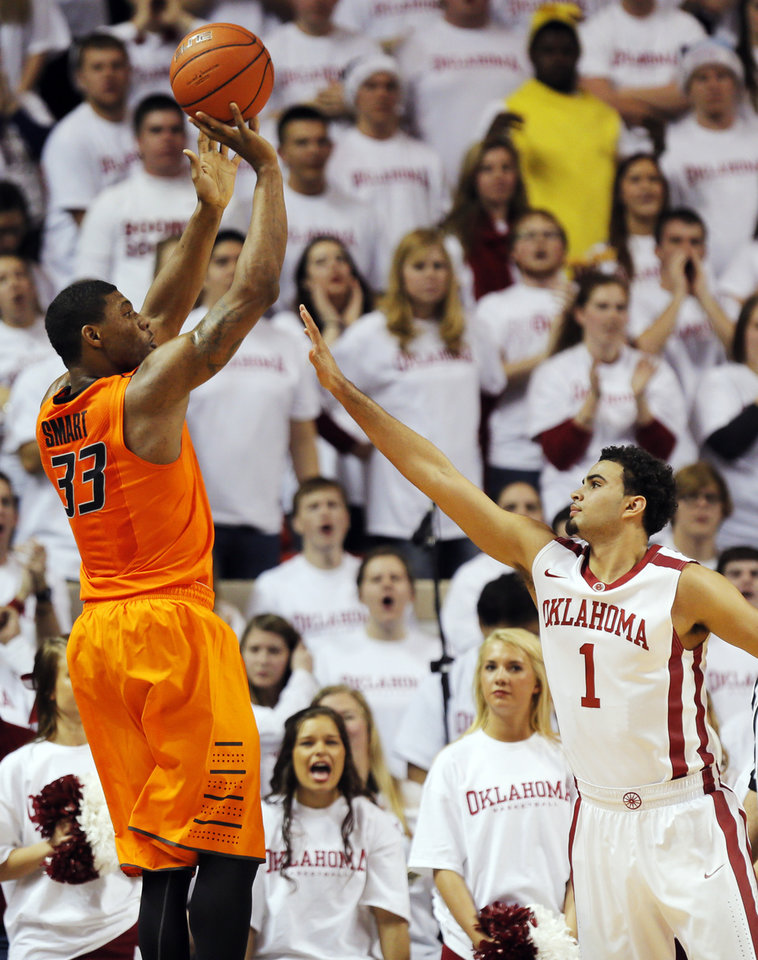 Photo - Oklahoma State's Marcus Smart (33) shoots over Oklahoma's Frank Booker (1) in the second half during the NCAA men's Bedlam basketball game between the Oklahoma State Cowboys (OSU) and the Oklahoma Sooners (OU) at Lloyd Noble Center in Norman, Okla., Monday, Jan. 27, 2014. OU won, 88-76. Photo by Nate Billings, The Oklahoman