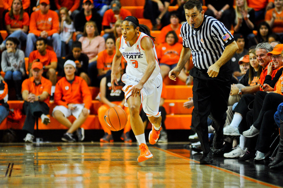 Oklahoma State junior guard Tiffany Bias dribbles the floor across half court during the cowgirls 101-49 victory over Weber State on November 18, 2012 in Gallagher Iba Arena. The game took place one day after the one year anniversary of the plane crash which took the lives of head coach Kurt Budke and assistant coach Miranda Serna. KT King/For the Tulsa World