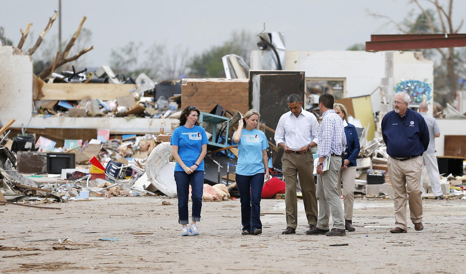 Photo - President Barack Obama tours tornado area at Plaza Towers Elementary with Principal Amy Simpson in Moore, Okla., on Sunday, May 25, 2013. Photo by Bryan Terry The Oklahoman