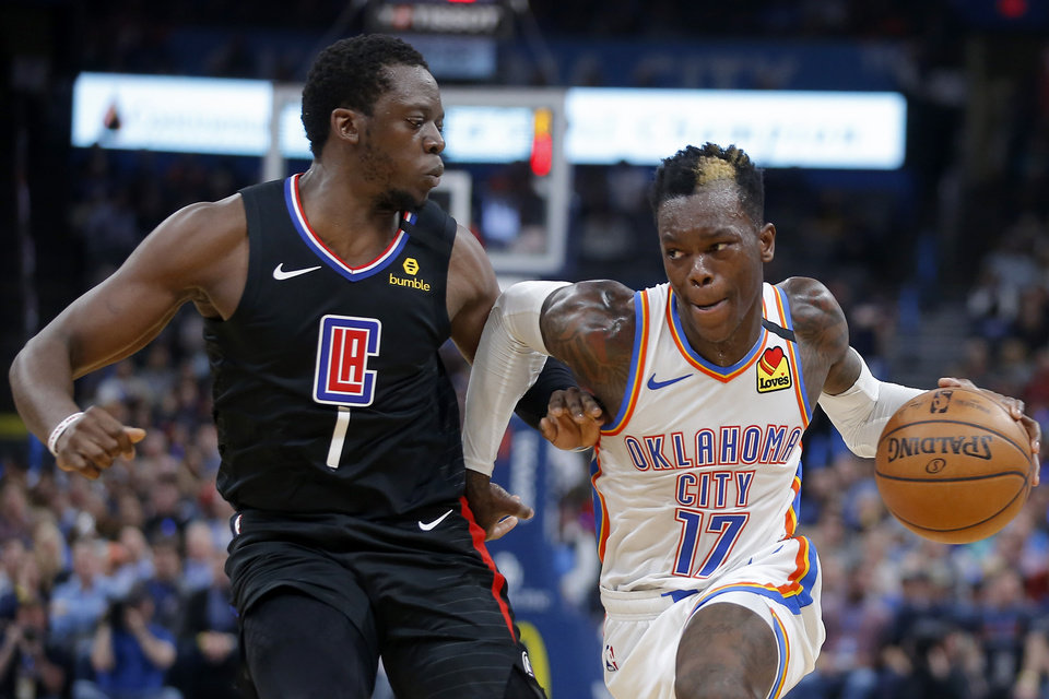 Photo - Oklahoma City's Dennis Schroder (17) goes past LA's Reggie Jackson (1) during an NBA basketball game between the Oklahoma City Thunder and the Los Angeles Clippers at Chesapeake Energy Arena in Oklahoma City, Tuesday, March 3, 2020. [Bryan Terry/The Oklahoman]