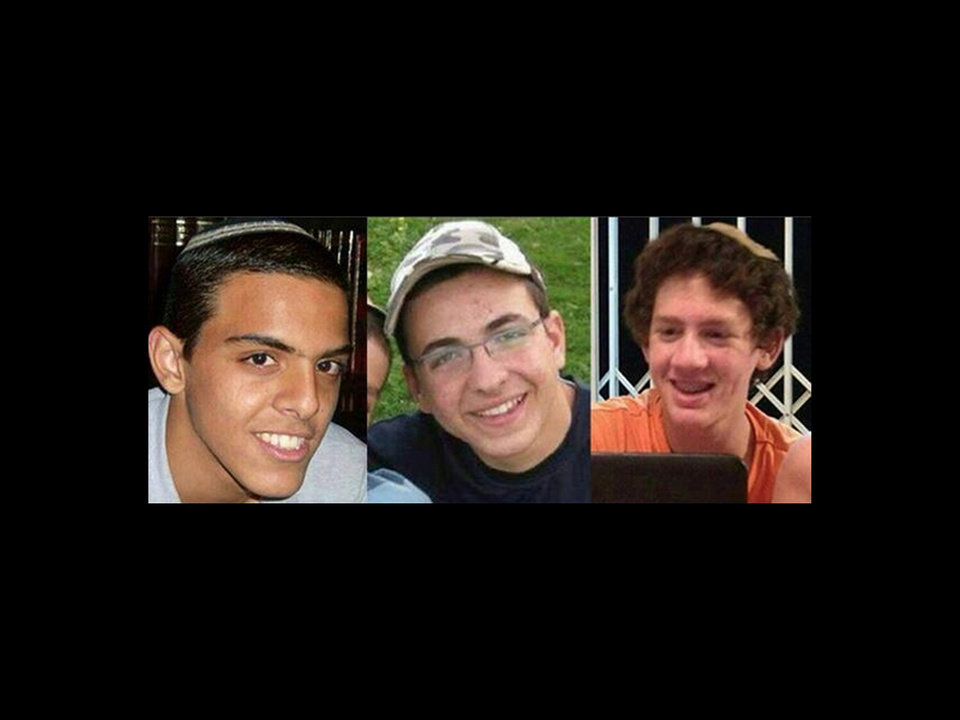 Photo - This undated image released by the Israel Defense Forces shows a combination of three photos of Israeli teens Eyal Yifrah, 19, Gilad Shaar, 16, and Naftali Fraenkel, a 16-year-old with dual Israeli-American citizenship, who disappeared while hitchhiking home near the West Bank city of Hebron late at night on June 12, 2014 and were never heard from again. The Israeli military found the bodies of the three missing teenagers on Monday, June 30, 2014, just over two weeks after they were abducted in the West Bank, allegedly by Hamas militants. The grisly discovery culminated a feverish search that led to Israel's largest ground operation in the Palestinian territory in nearly a decade and raised fears of renewed fighting with Hamas.(AP Photo/Israel Defense Forces)