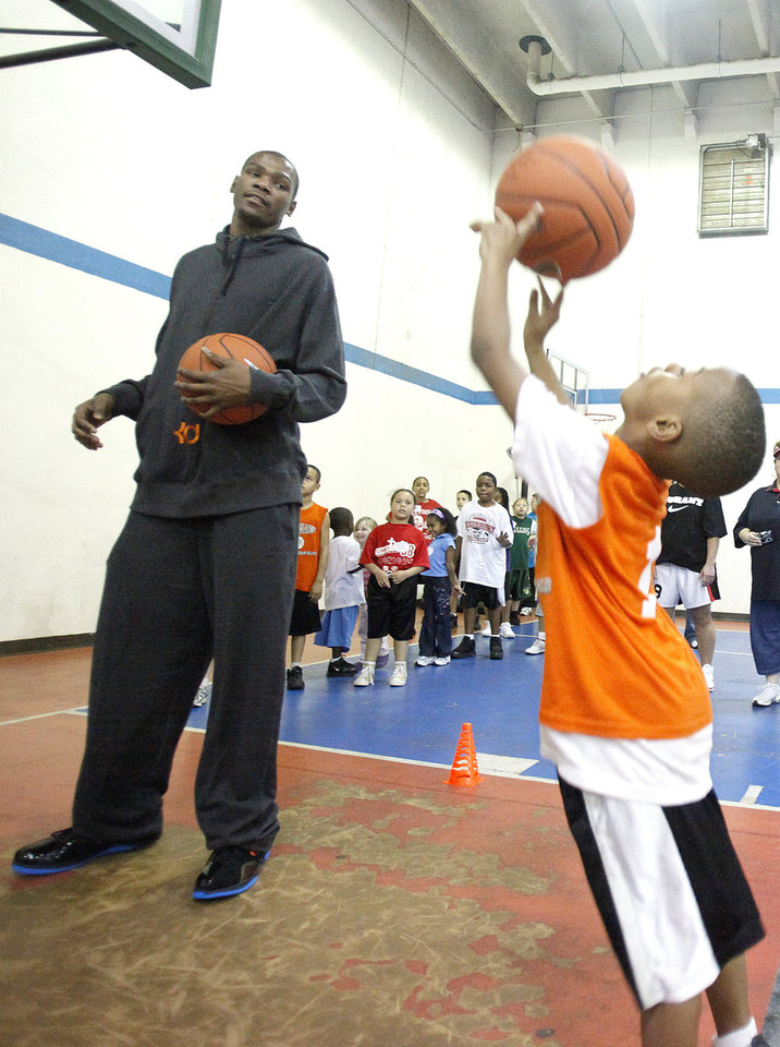 Kevin Durant watches Tristian Stoner shoot a basket during the Nike Clinic at the Salvation Army Boy and Girls  Club, Saturday, Feb. 7, 2009, in Oklahoma City. PHOTO BY SARAH PHIPPS, THE OKLAHOMAN