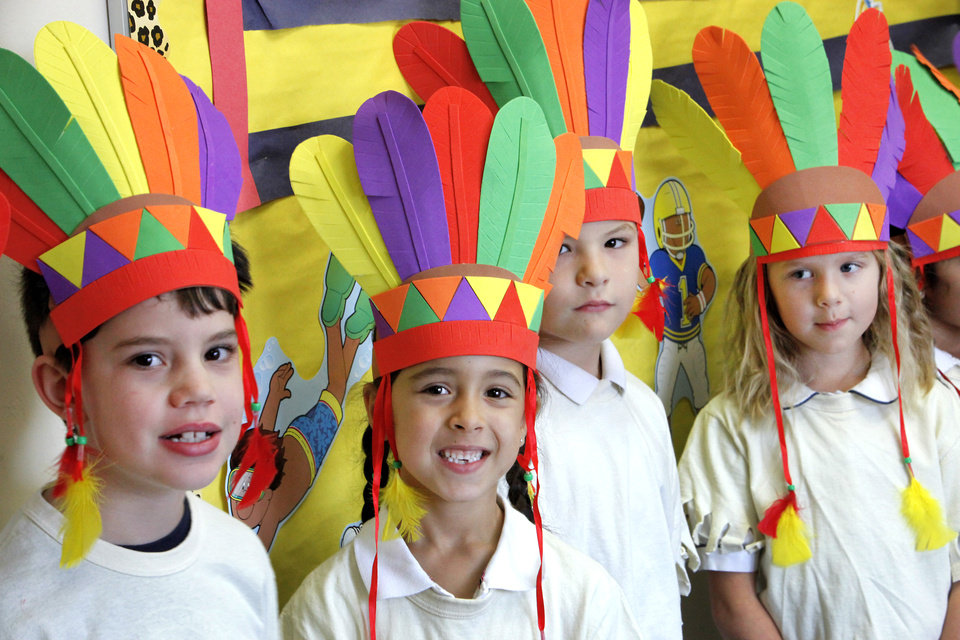 First-graders Brogan Holt, Alya Bakir, Issac Johnson and Lakein Ruble wear Indian headdress for the Thanksgiving pageant at St. Mary\'s Episcopal School on E Covell in Edmond, Tuesday, November 20, 2012. Photo By David McDaniel/The Oklahoman