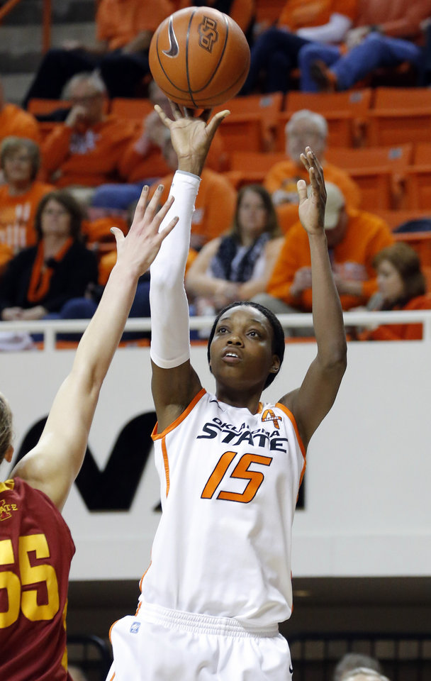 Photo - Oklahoma State's Toni Young (15) shoots over Iowa State's Anna Prins (55) during the women's college basketball game between Oklahoma State and Iowa State at  Gallagher-Iba Arena in Stillwater, Okla.,  Sunday,Jan. 20, 2013.  OSU won 71-42. Photo by Sarah Phipps, The Oklahoman