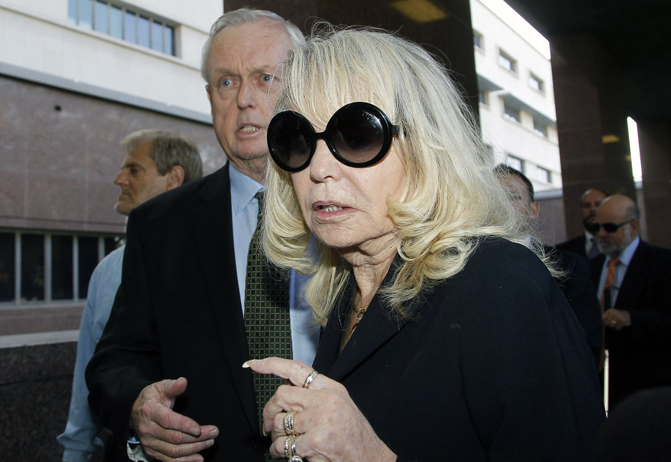Photo - Shelly Sterling, the estranged wife of Los Angeles Clippers owner Donald Sterling, arrives at a Los Angeles courthouse with her attorney Pierce O' Donnell, Monday, July 7, 2014. With the potentially record-breaking $2 billion sale of the Clippers hanging in the balance, a trial beginning Monday will focus on Shelly Sterling had the authority under terms of a family trust to unilaterally negotiate the deal.  (AP Photo/Nick Ut)
