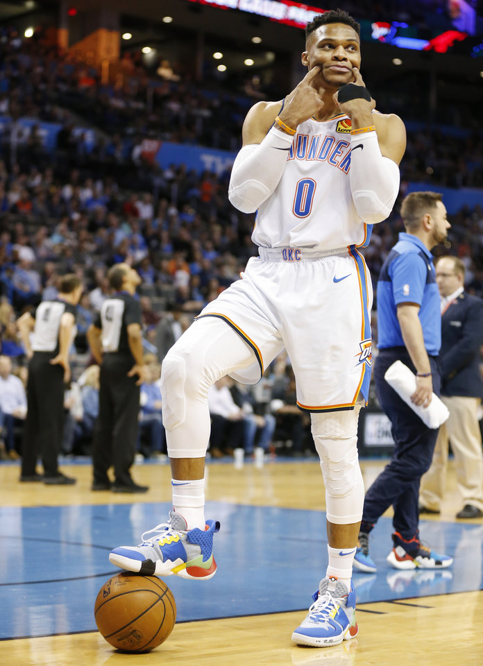 Photo - Oklahoma City's Russell Westbrook (0) places his foot on the ball and makes a smiling face during a break in the action in the first quarter of an NBA basketball game between the Los Angeles Lakers and the Oklahoma City Thunder at Chesapeake Energy Arena in Oklahoma City, Tuesday, April 2, 2019. Photo by Nate Billings, The Oklahoman
