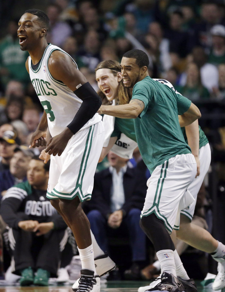 Photo - Boston Celtics' Jeff Green, left, reacts after making a basket in the second quarter of an NBA basketball game against the Cleveland Cavaliers in Boston, Saturday, Dec. 28, 2013. (AP Photo/Michael Dwyer)