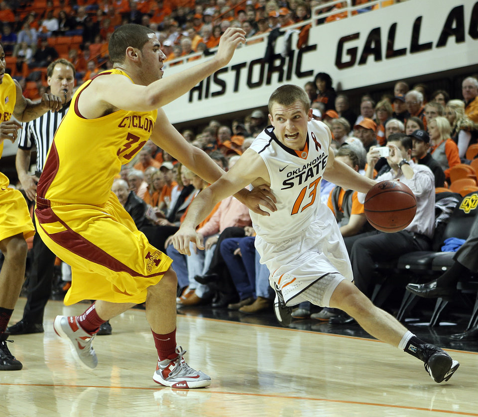 Oklahoma State\'s Phil Forte (13) drives past Iowa State Cyclones\' Georges Niang (31) during the college basketball game between the Oklahoma State University Cowboys (OSU) and the Iowa State University Cyclones (ISU) at Gallagher-Iba Arena on Wednesday, Jan. 30, 2013, in Stillwater, Okla. Photo by Chris Landsberger, The Oklahoman