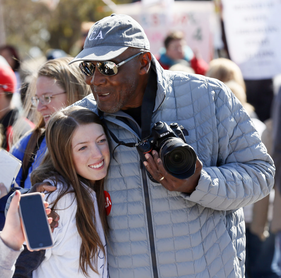 Photo - Carl Albert coach Tex Rollins hugs Carl Albert junior Cadley Schafer, 17, during a rally led by students on the third day of a walkout by Oklahoma teachers at the state Capitol in Oklahoma City, Wednesday, April 4, 2018. Photo by Nate Billings, The Oklahoman