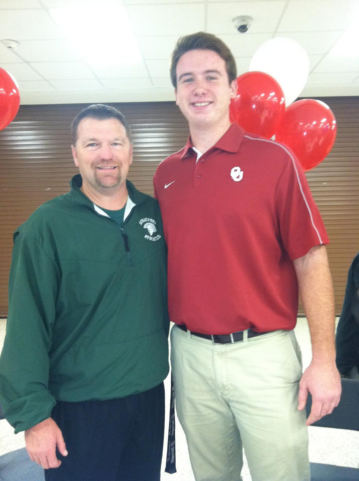 Photo - Oklahoma football signee Christian Daimler poses with Houston Stratford coach Dean Allen after Daimler signed a letter of intent to play for the Sooners. PHOTO PROVIDED