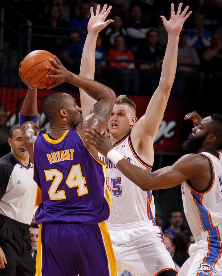 Oklahoma City's Cole Aldrich (45) and James Harden (13) defend Los Angeles' Kobe Bryant (24) during an NBA basketball game between the Oklahoma City Thunder and the Los Angeles Lakers at Chesapeake Energy Arena in Oklahoma City, Thursday, Feb. 23, 2012. Photo by Bryan Terry, The Oklahoman