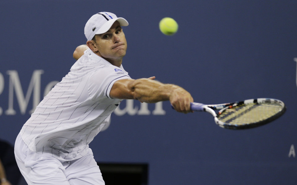Photo -   Andy Roddick returns a shot to Australia's Bernard Tomic in the third round of play at the 2012 US Open tennis tournament, Friday, Aug. 31, 2012, in New York. (AP Photo/Charles Krupa)