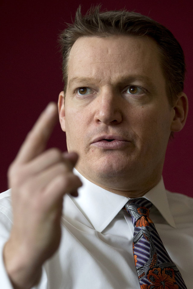 Photo - Mandiant founder and CEO Kevin Mandia is seen in his office in Alexandria, Va., Wednesday, Feb. 20, 2013. Mandiant, started in 2004 by Mandia, a private technology security firm described in extraordinary detail efforts it blamed on a Chinese military unit to hack into 141 businesses, mostly inside the U.S., and steal commercial secrets. China denies the claim.   (AP Photo/Jacquelyn Martin)