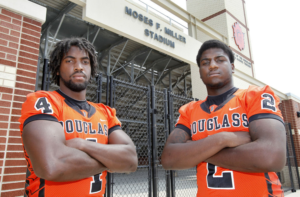 Douglass High School defensive ends D.J. Ward, left, and Deondre Clark stand in front of the gate of Moses F. Miller Stadium at Douglass High School inOklahoma City, OK, Friday, August 17, 2012,  By Paul Hellstern, The Oklahoman <strong>PAUL HELLSTERN - Oklahoman</strong>