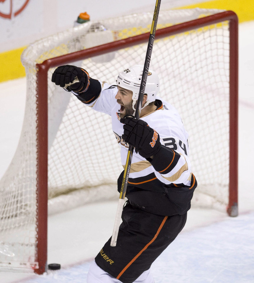Photo - Anaheim Ducks right wing Daniel Winnik (34) celebrates teammate Kyle Palmieri's goal during the second period of NHL action against the Vancouver Canucks in Vancouver on Monday, April 7, 2014. (AP Photo/The Canadian Press, Jonathan Hayward)