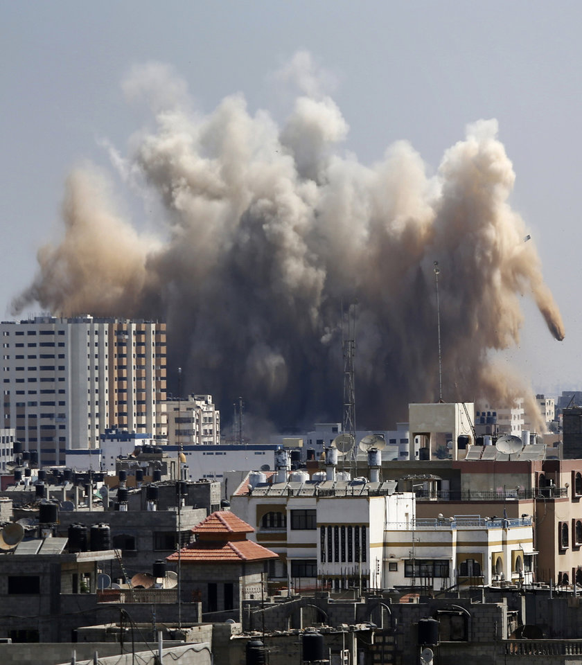 Photo - Smoke, dust and debris rise over Gaza City after an Israeli strike, Friday, Aug. 8, 2014, as Israel and Gaza militants resumed cross-border attacks after a three-day truce expired and Egyptian-brokered talks on a new border deal for blockaded Gaza hit a deadlock. (AP Photo/Hatem Moussa)