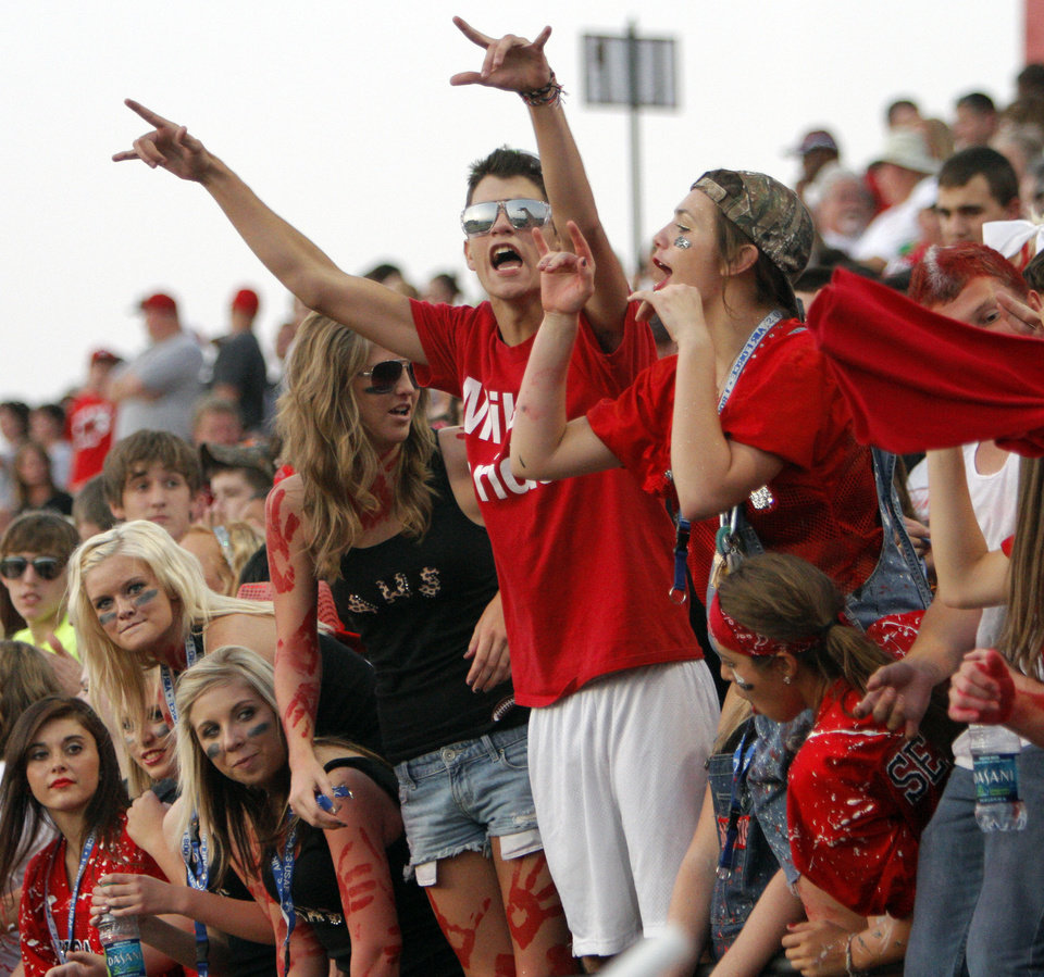 Photo - Yukon fans cheer during a high school football game between Yukon and Mustang at Mustang High School in Mustang, Okla., Friday, Sept. 2, 2011. Photo by Nate Billings, The Oklahoman