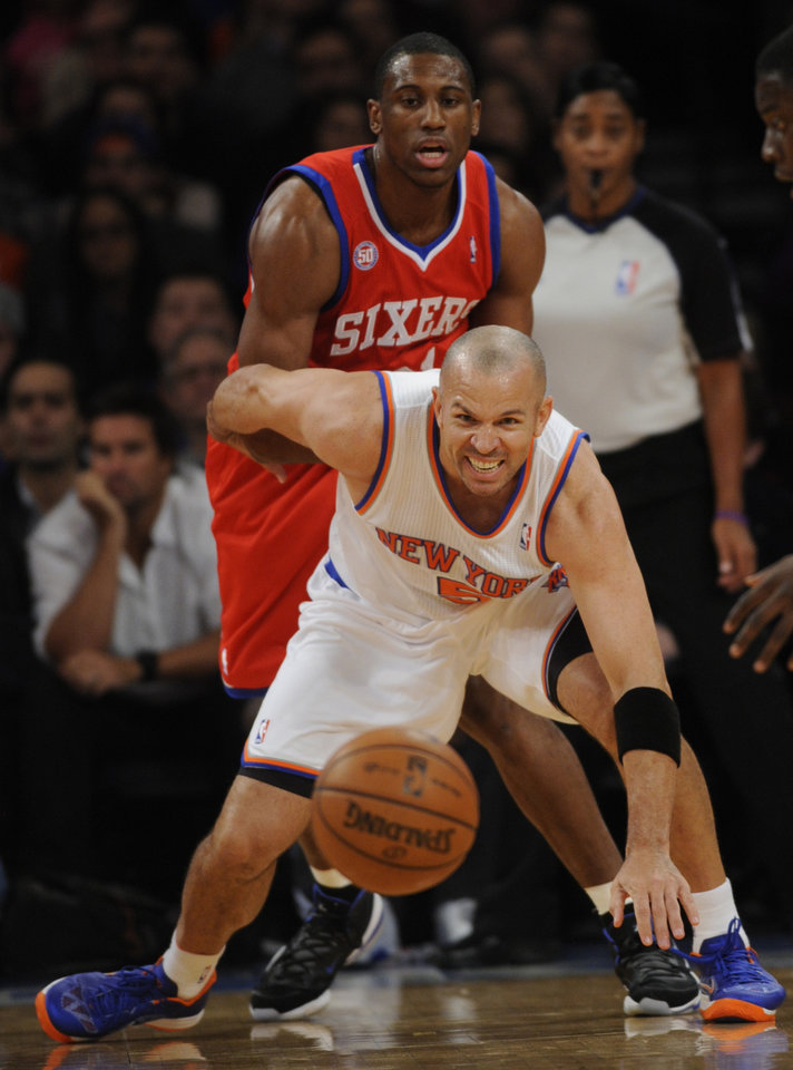 New York Knicks\' Jason Kidd, front, and Philadelphia 76ers Nick Young chase a loose ball in the first quarter of the NBA basketball game at Madison Square Garden in New York, Sunday, Nov. 4, 2012. (AP Photo/Henny Ray Abrams)