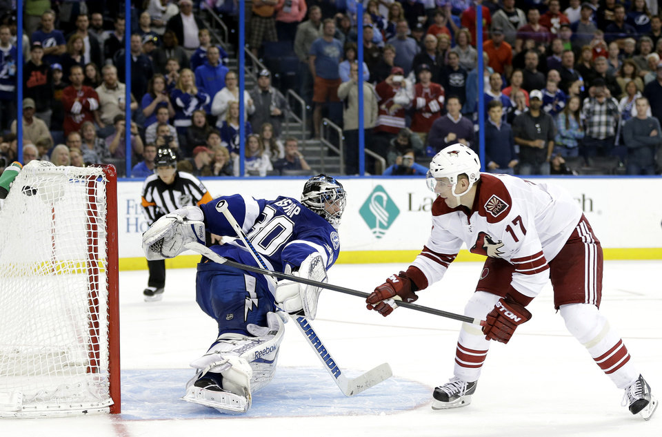 Photo - Phoenix Coyotes right wing Radim Vrbata (17), of the Czech Republic, beats Tampa Bay Lightning goalie Ben Bishop for a goal in a shoot out an NHL hockey game Monday, March 10, 2014, in Tampa, Fla. The Coyotes won the game 4-3. (AP Photo/Chris O'Meara)