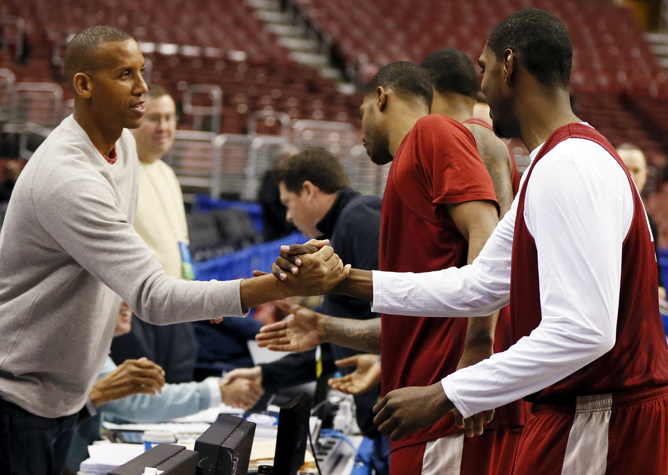 Oklahoma's Andrew Fitzgerald (4), right, shakes hands with Reggie Miller as the OU players greet the national broadcast team during the practice and press conference day for the second round of the NCAA men's college basketball tournament at the Wells Fargo Center in Philadelphia, Thursday, March 21, 2013. OU will play San Diego State in the second round on Friday. Photo by Nate Billings, The Oklahoman