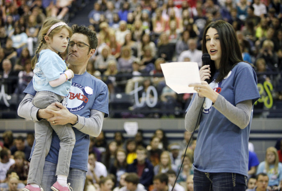 Ryan and Alyssa Siler hold their daughter Hayden and thank students for raising money for Cystic Fibrosis research as Edmond North High School holds its reporting assembly at the conclusion of BALTO week in Edmond, OK, Friday, Feb. 17, 2012. By Paul Hellstern, The Oklahoman