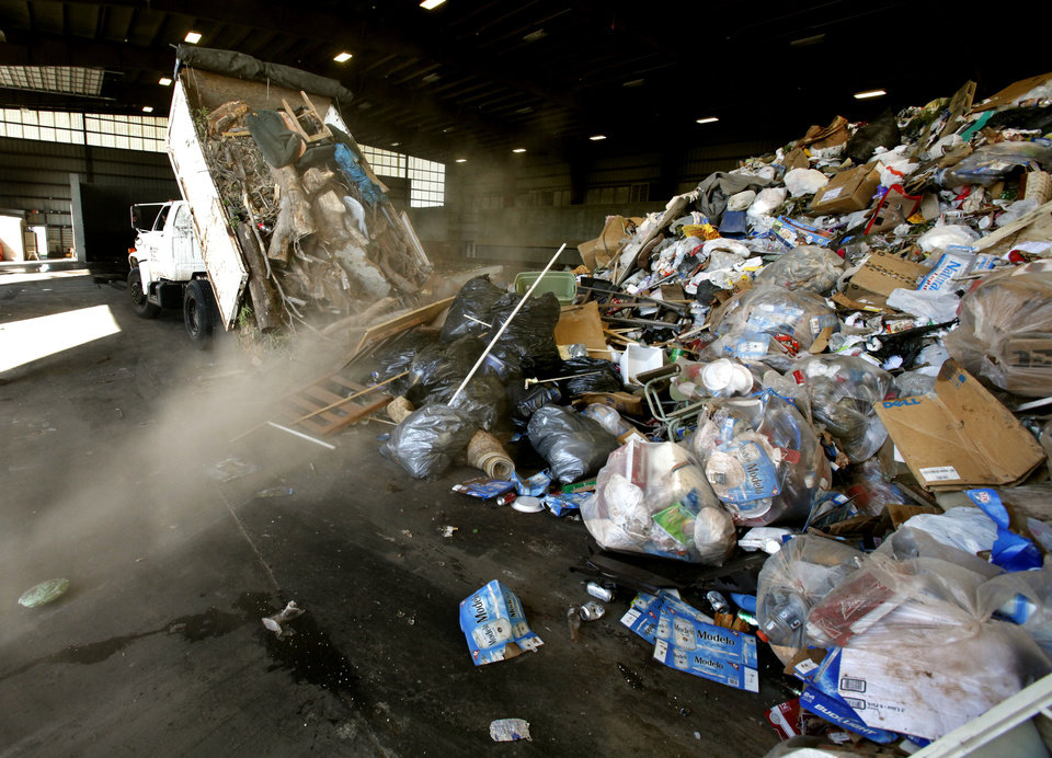 Norman sanitation crews dump a load of trash Tuesday at the city's transfer station. PHOTO BY STEVE SISNEY, THE OKLAHOMAN <strong>STEVE SISNEY</strong>