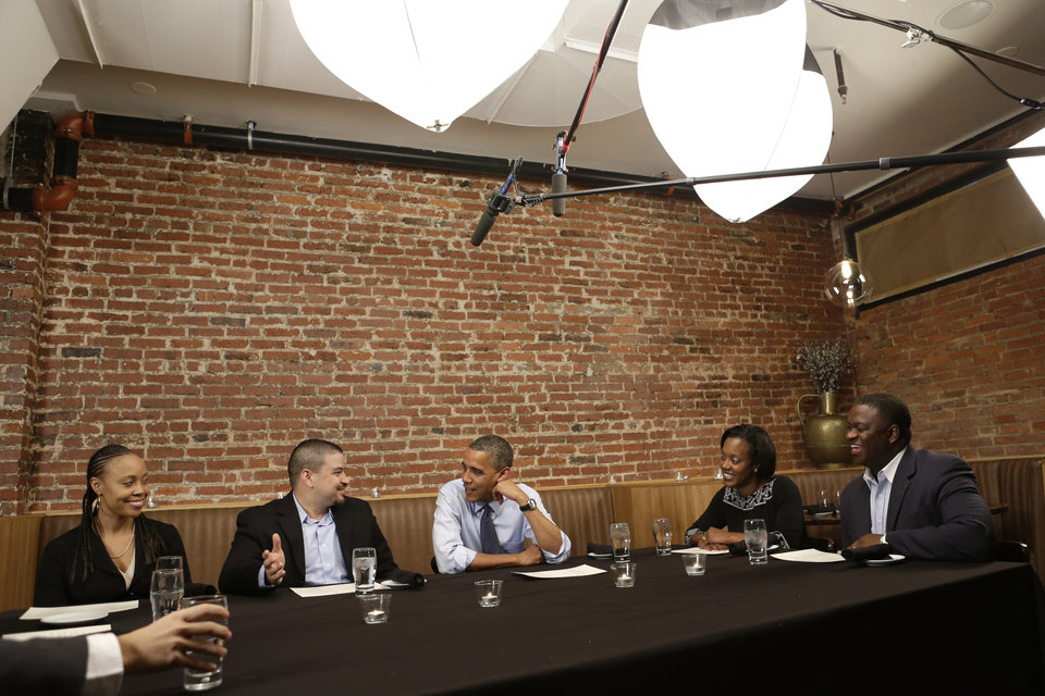President Barack Obama, center, meets with winners of a campaign fundraising contest, at Smith Commons Dining Room and Public House in Washington, on Friday, Oct. 12, 2012. At left are Deidra Orosa, and her husband Mario Orosa, of North Canton, Ohio, and to the right of the President are Kimberley Cathey, and her husband Ron Cathey, of Greensboro, N.C. (AP Photo/Jacquelyn Martin)