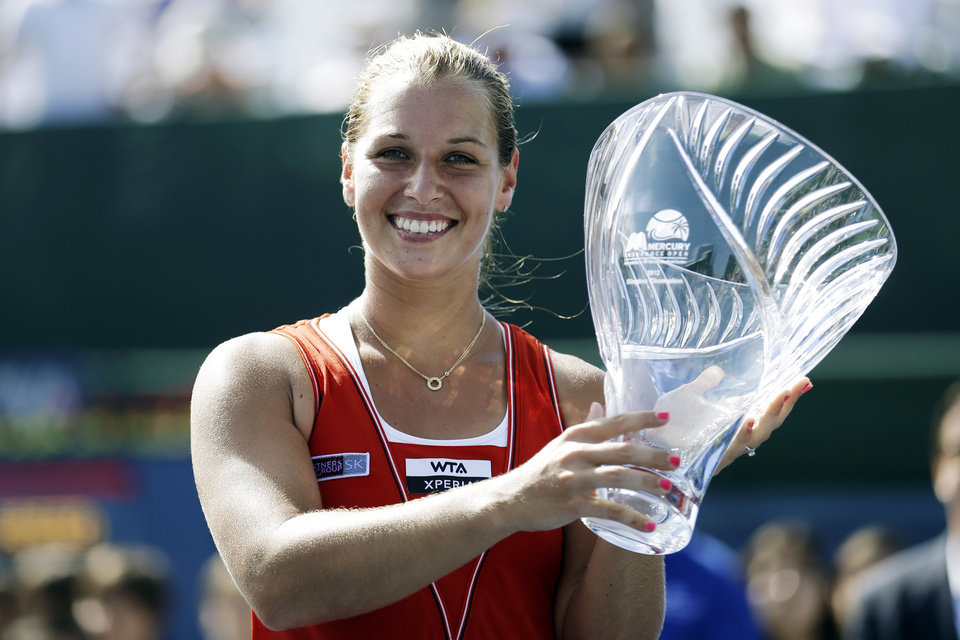 Dominika Cibulkova, of Slovakia, kisses the trophy after defeating Marion Bartoli, of France, in the final match of the Mercury Insurance Open tennis tournament, Sunday, July 22, 2012, in Carlsbad, Calif. Cibulkova won 6-1, 7-5. (AP Photo/Gregory Bull)