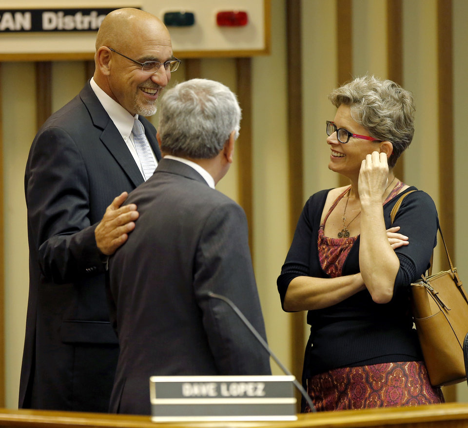 Photo -  New Oklahoma City Public Schools Superintendent Rob Neu, left, talks with outgoing Interim Superintendent Dave Lopez and Board Member Laura Massenat before a school board meeting Tuesday. Photo by Bryan Terry, The Oklahoman   Bryan Terry -  THE OKLAHOMAN