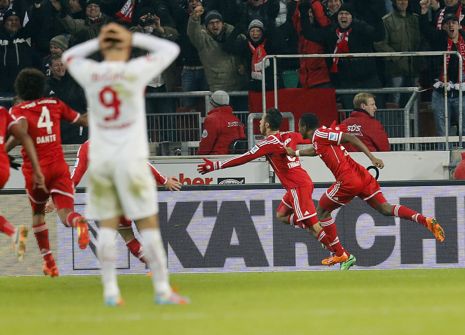 Photo - Bayern's Thiago Alcantara of Spain, center, celebrates his side's winning goal during a German first soccer division Bundesliga match between VfB Stuttgart and FC Bayern Munich in Stuttgart, Germany, Wednesday, Jan. 29, 2014. (AP Photo/Michael Probst)