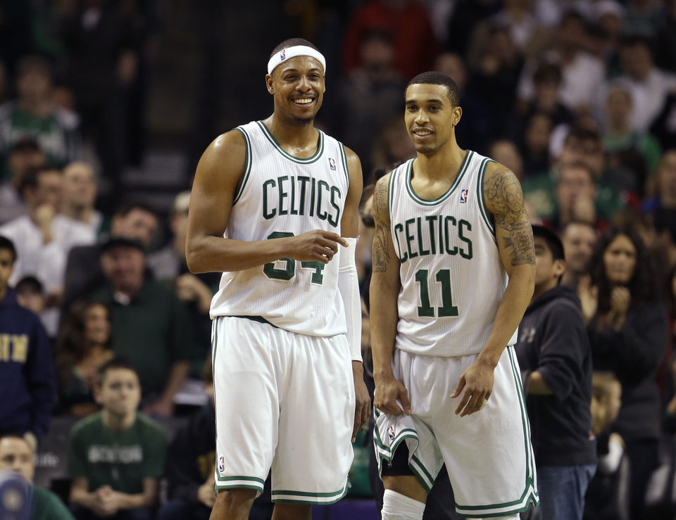 Photo - Boston Celtics forward Paul Pierce (34), left, and Celtics guard Courtney Lee (11), right, react seconds after the end of an NBA basketball game against the Los Angeles Clippers in Boston, Sunday, Feb. 3, 2013. The Celtics defeated the Clippers 106-104. (AP Photo/Steven Senne)