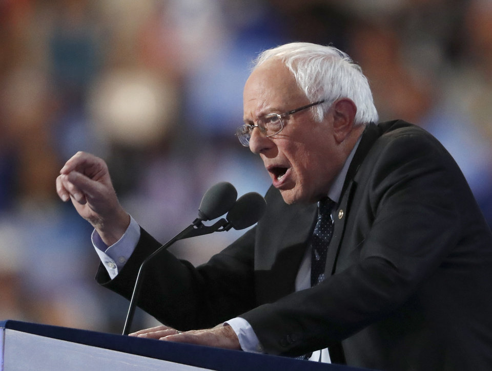 Photo - Former Democratic Presidential candidate, Sen. Bernie Sanders, I-Vt., speaks during the first day of the Democratic National Convention in Philadelphia , Monday, July 25, 2016. (AP Photo/Paul Sancya)