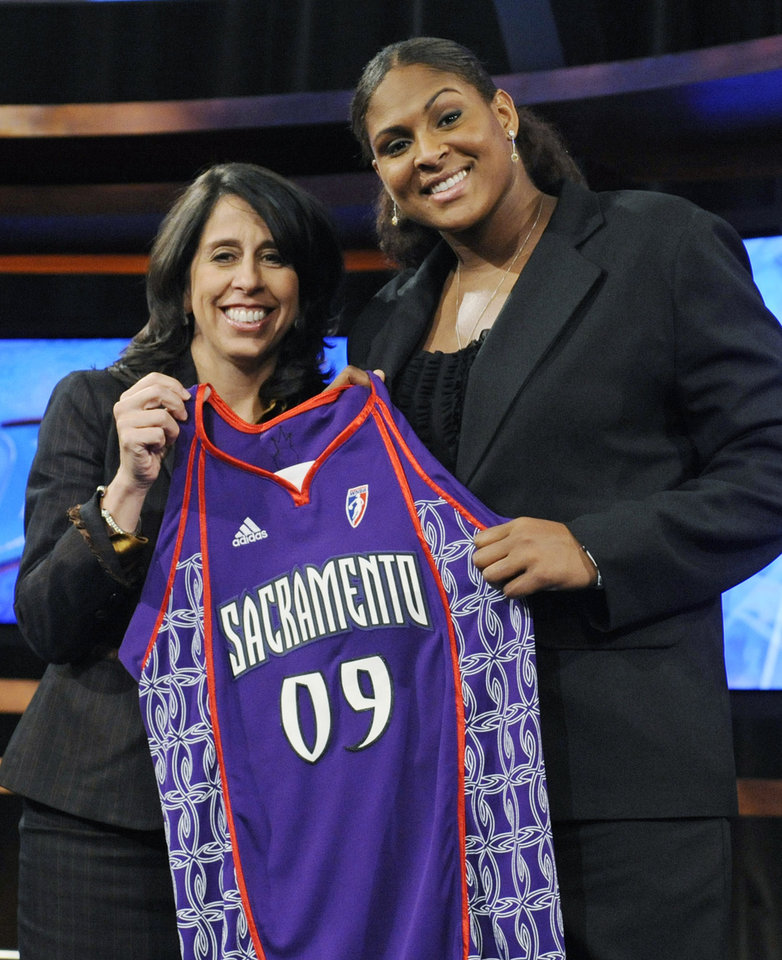 Oklahoma's Courtney Paris, right, holds up a Sacramento Monarchs jersey as she poses with WNBA president Donna Orender after Paris was chosen as the seventh pick overall in the WNBA basketball draft, Thursday, April 9, 2009, in Secaucus, N.J. (AP Photo/Bill Kostroun) ORG XMIT: NJBK107