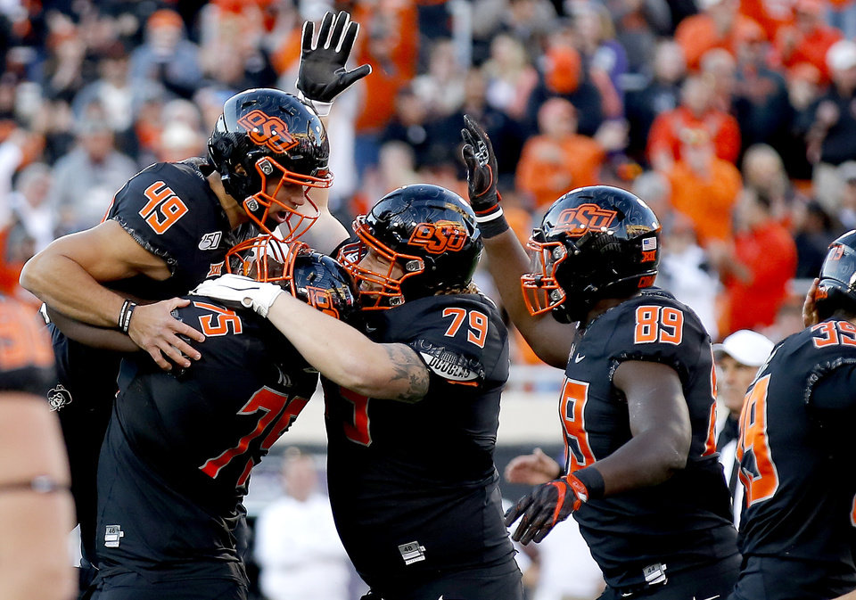 Photo - Oklahoma State's Matt Ammendola (49) kicks a 43-yard field goal with teammates in the fourth quarter during the college football game between the Oklahoma State University Cowboys and the TCU Horned Frogs at Boone Pickens Stadium in Stillwater, Okla.,  Saturday, Nov. 2, 2019. [Sarah Phipps/The Oklahoman]
