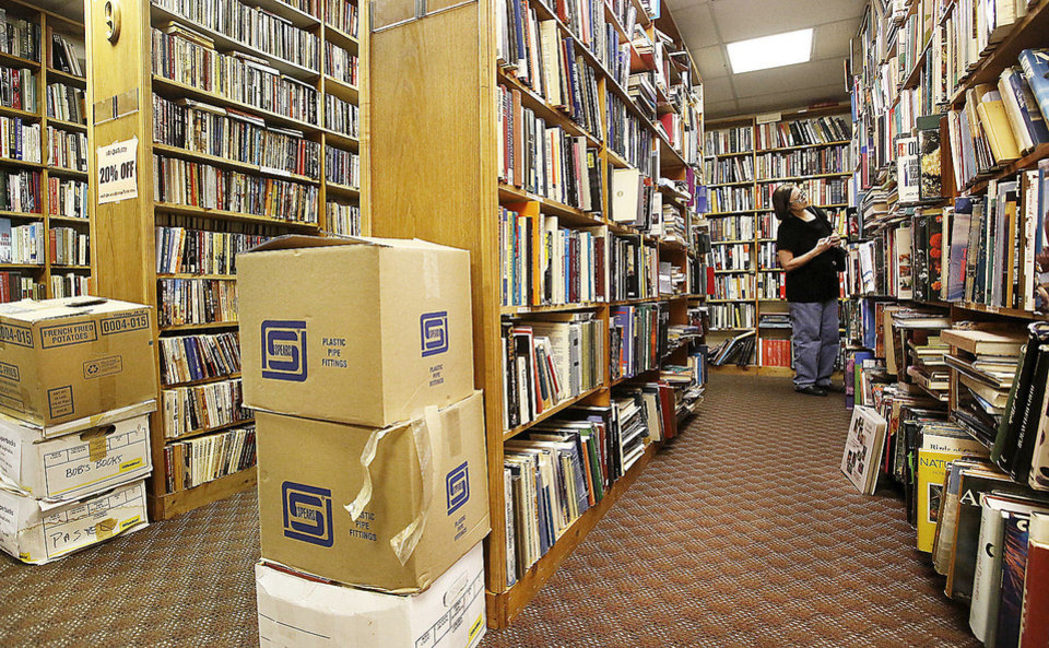 A woman searches for a book in the shelves at Aladdin Book Shoppe. Despite a fire that could have destroyed more than 40,000 rare and used books at a landmark Oklahoma City bookstore, Aladdin Book Shoppe remains open for customers last Saturday, Dec. 22, 2012. Photo by Jim Beckel, The Oklahoman