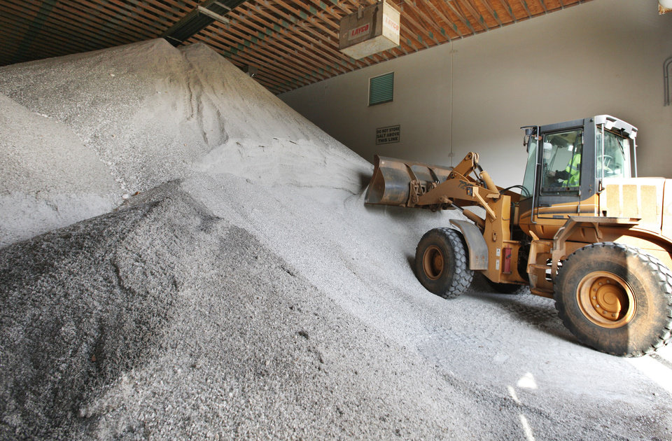 A city employee uses a front end loader to scoop up a load of salt at the salt storage barn for Oklahoma City Monday, Dec. 24, 2012. The salt is used in brine trucks to spray on bridges and mixed with sand to spread on city streets in icy weather. Photo by Paul B. Southerland, The Oklahoman