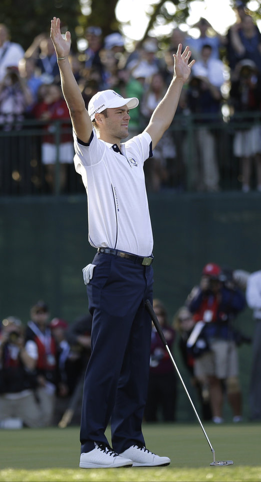 Europe's Martin Kaymer reacts after winning his match on the 18th hole to clinch a Europe win during a singles match at the Ryder Cup PGA golf tournament Sunday, Sept. 30, 2012, at the Medinah Country Club in Medinah, Ill. (AP Photo/David J. Phillip)  ORG XMIT: PGA193
