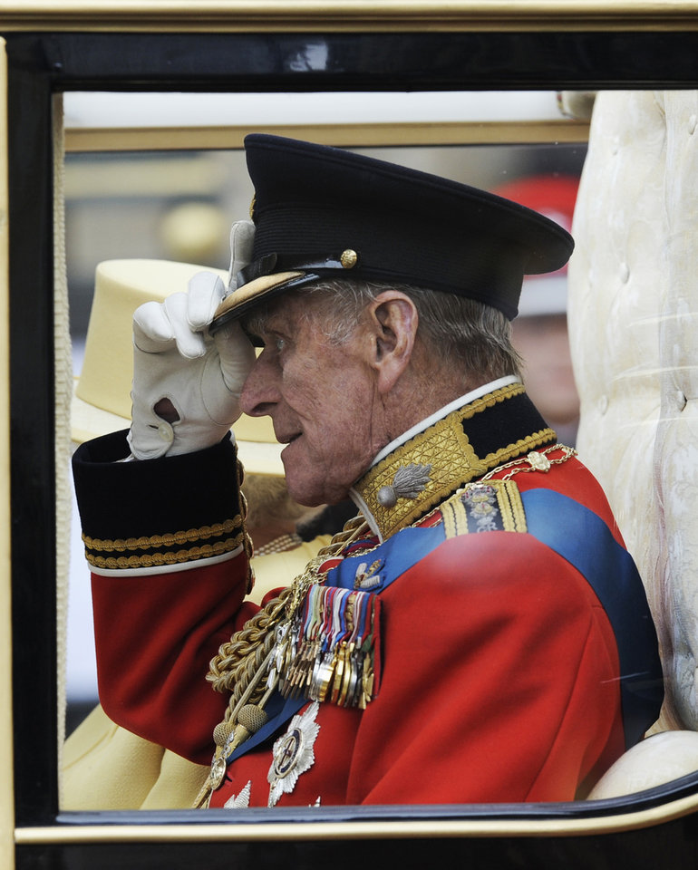 Photo - Britain's Prince Philip  adjusts his cap outside of Westminster Abbey after the Royal Wedding for Britain's Prince William and Kate Middleton in London Friday, April, 29, 2011. (AP Photo/Martin Meissner)