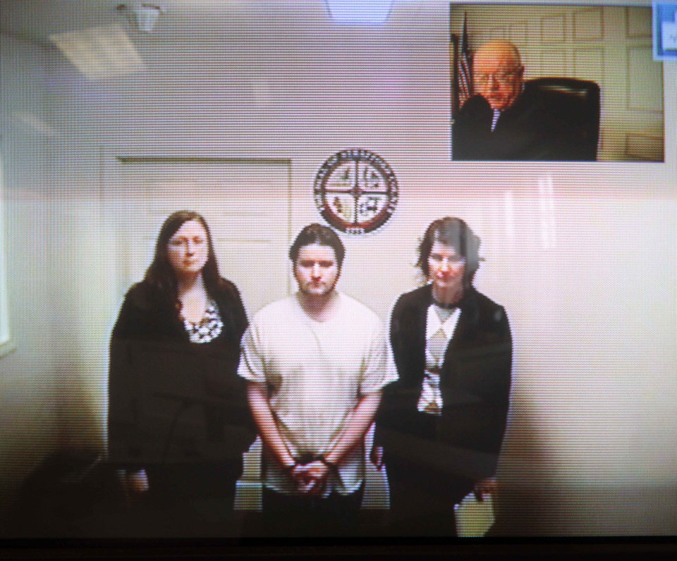 Photo -   Seth Mazzaglia, bottom center, is seen during his video arraignment from the Strafford County jail in Dover, N.H. to the district court in Dover Monday, Oct. 15, 2012. Mazzaglia was charged with killing Elizabeth