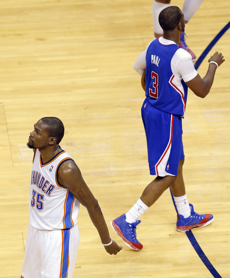 Oklahoma City's Kevin Durant (35) walks away from Los Angeles' Chris Paul (3) after Durant was called for a foul during Game 1 of the Western Conference semifinals in the NBA playoffs between the Oklahoma City Thunder and the Los Angeles Clippers at Chesapeake Energy Arena in Oklahoma City, Monday, May 5, 2014. Photo by Bryan Terry, The Oklahoman