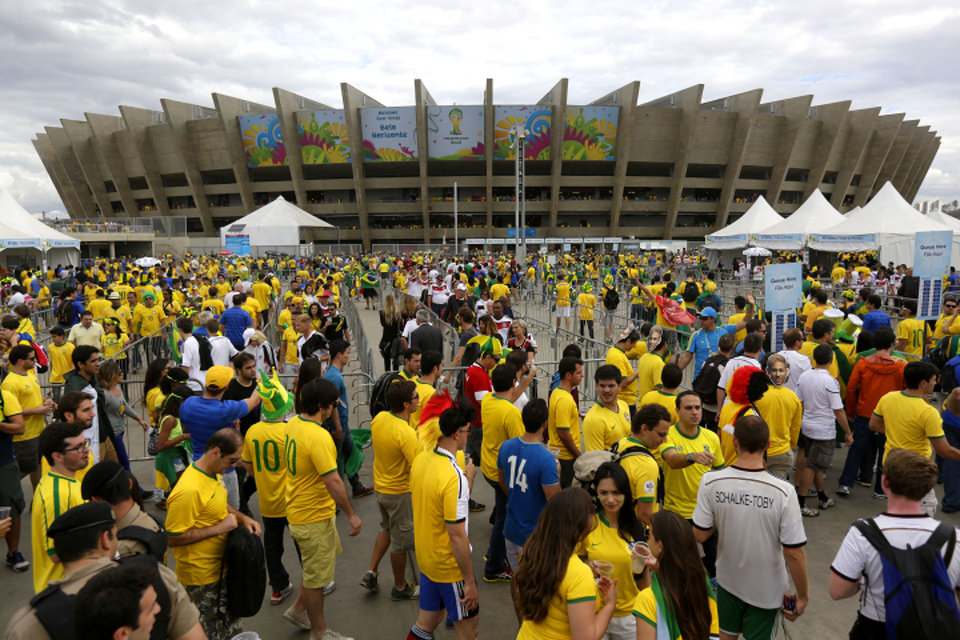 Photo - Soccer fans arrives to Mineirao Stadium for the semifinal World Cup match between Brazil and Germany in Belo Horizonte, Brazil, Tuesday, July 8, 2014. (AP Photo/Bruno Magalhaes)