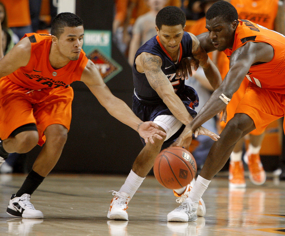 Oklahoma State's Cezar Guerrero (1) and Oklahoma State's Jean-Paul Olukemi (0) go for the ball beside Texas-San Antonio's Michael Hale (5) during an NCAA college basketball game between the Oklahoma State University Cowboys (OSU) and the University of Texas-San Antonio Roadrunners at Gallagher-Iba Arena in Stillwater, Okla., Wednesday, Nov. 16, 2011. Photo by Bryan Terry, The Oklahoman