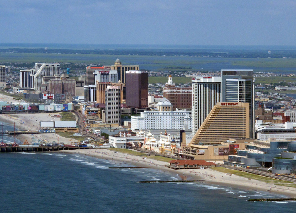 Photo - FILE - This July 11, 2014 file photo shows many of the Atlantic City N.J. Boardwalk casinos. The rapid disintegration of Atlantic City's casino market might be an early indicator of what could happen in other parts of the country that have too many casinos and not enough gamblers. (AP Photo/Wayne Parry, File)